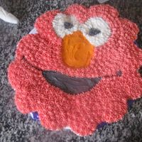 Elmo Cupcake Cake This is cupcakes. I used the shaped Elmo pan to draw the shape onto the cake board. Then just put the cupcakes on the shape. Frosted with...