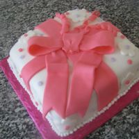 Wilton Class Cake Made this at one of the Wilton classes. Dont remember if it was course two or three. Covered in fondant.
