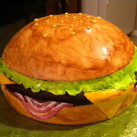 Cheeseburger   Cake: 1 - 8 inch round and 1 - soccer ball pan filled and covered in fondant.All decorations made from fondant, and hand-painted.