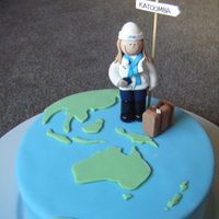 Birthday Cake - Traveller Theme A birthday cake for my friend who likes to travel. A chocolate mud cake with fondant icing. I made the person and luggage from fimo (...