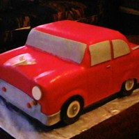 57 Chevy Cake  This was for my step-mothers birthday. This was her favorite vintage car. She loved and all of her guest loved it too. Yellow cake with...