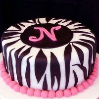 Zebra Stripes I made this cake for a 13-year-old's birthday. The cake is a white cake with strawberry buttercream filling. The cake covering and...