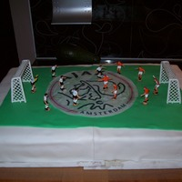 Soccer Soccer cake for a girl that loves soccer, with the logo of her favorite team, AJAX.