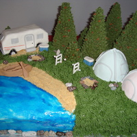Camping Cake Smore's Cake with RKT tents and camper, graham cracker crumb sand, ice cream cone w/royal icing piping for trees.
