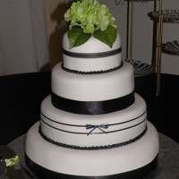 Black And White Wedding   Wedding cake covered in fondant and ribbon.