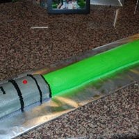 "Lightsaber Cake  Chocolate cake (cut from 9x13 pan) shaped into lightsaber. All BC decorations (with the exception of the red ""gobstopper"" for the..."