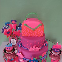 Zoe 21 The cake was design to my daughter friend. The purse is styrofoam. The cakes, cup cakes and cookies, flowers I made it.
