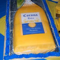 Corona Beer Bottle Cake Vanilla cake with pineapple filling, covered in fondant.