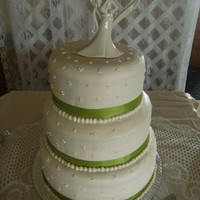 Swiss Dot Wedding Cake covered with fondant then added swiss dots from buttercream