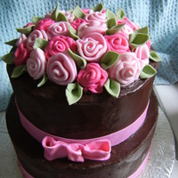 Rose Cake french vanilla cake with buttercream filling and chocolate ganache covering it fondant ribbon roses and fondant leaves! the first time...