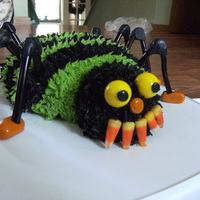 Spider chocolate cake with cherry pie filling to be like guts decorated with buttercream. licorice legs, candy face