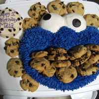 Cookie Monster wilton elmo cake pan decorated like cookie monster with cookies shoved in his mouth
