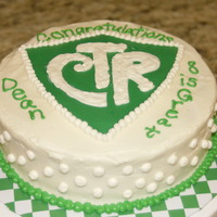 Ctr Cake Green shield is fondant, rest is buttercream. For a friend's son's LDS baptism.