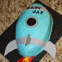 Rocket Ship Buttercream with fondant accents and gumpaste tail fins.