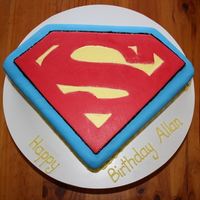 Superman Logo White Chocolate mud cake covered with buttercream and fondant.