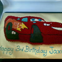 Lightning Mcqueen   Buttercream covered chocolate cake.