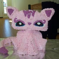 My Littlest Pet Shop Kitty I made this cake for a friend .. the body was a bear stand up cake chopped the head of and made head, tail and front legs out of rie cripie...