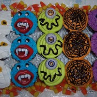 Scary Cupcakes these cupcakes were to go along with a pumpkin cake I made for a halloween themed birthday they are super cute . chocolate cupcakes with...