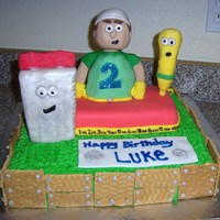 Handy Manny this cake I made for my friends 2 year old he loves handy manny characters are made of rice crispie treats and covered in fondant. cake is...