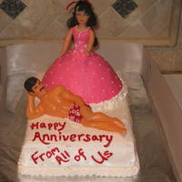 "Hey Baby This was an anniversary cake for a friends parents. They are ""dressed"" in clothes that they always wear. Everyone got a good..."