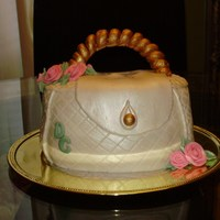 Purse Cake   Flowers made from Gumpaste, cake covered in fondant. My first attempt at making a purse cake.