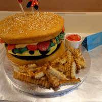 Cheeseburger And Fries Cake Yellow cake for the hamburger bun, a brownie for the hamburger patty, and poundcake for the fries.