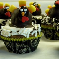 Halloween/thanksgiving Hybrids These were for a birthday that fell between Halloween and Thanksgiving--the turkeys on each cupcake are cake balls.
