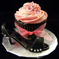 Birthday Cupcake And Shoe Jumbo sized chocolate cupcake with raspberry buttercream frosting. Gumpaste shoe.