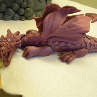 Fire Breathing Dragon Made from fondant and tylose mixture. The flames are gumpaste, painted with the Wilton spray colors.