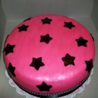 Starry Eyes Pink fondant with black stars...all covered in pearl dust for shimmer.