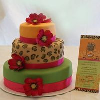 Leopard Hawaiian Cake This cake is done in fondant. Leopard spots are fondant also! Made this cake to match the invitation!