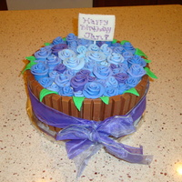 Barrel Of Roses  Thank you to bakedbylisa whose cake I copied. This is one of two cakes I made for my boss' birthday. She loves roses and the color...