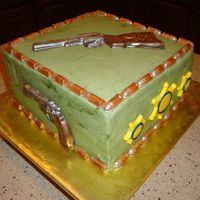 Guns, Bullets, & Badges Cake  Made for a Lt. transferring at my husband's job. I had badges made in gold, but my husband really wanted the bright yellow ones...