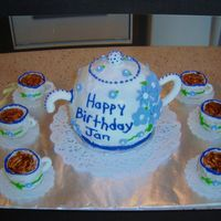 Teapot Birthday Cake  I made this for my boss for her birthday. She loves tea and collects teapots. I know it is a little rough, but I have gotten much better at...