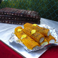 "Ribs And Corn-On-The-Cob I made this for my cousin's birthday and annual adult cookout. There are 4 ""slabs of ribs"" covered in BC and the ears of..."