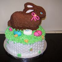 Easter Bunny In A Basket All buttercream with fondant decorations.