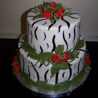 Zebra Print And Red Roses Zebra painted fondant with red ribbon roses.