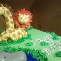 Jungle Fondant animals, fondant tie-dye marbled covered cake, this one was fun and they loved it.