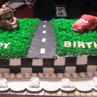 Cars Cake   figures made with rk covered in mmf, cake 1/2 white, 1/2 chocolate, bc and mmf accents,