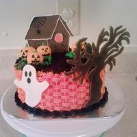 A Boo-Tiful Halloween Yellow cake with butter cream icing (basket weave)..Dirt is crushed oreo cookies..ghost and pumpkins are gumpaste..tree is made out of...