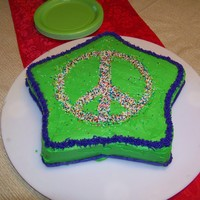 Peace Sign Birthday Cake My daughter's 10th birthday. She requested green, purple, and a peace sign. The girls at the slumber party loved it and devoured the...