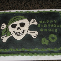 Pirate Birthday Buttercream frosting airbrushed black with a hand drawn buttercream pirate.