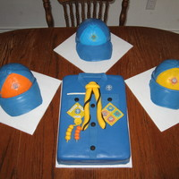 Cub Scout Uniform White cakes, iced in buttercream, covered in fondant, fondant details