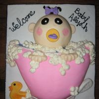 Baby Girl In Bath Tub Baby Shower Cake This was made for my son's preschool teacher. It is a baby girl in a bathtub with plenty of bubbles, a ducky and a bar of soap! Fun...