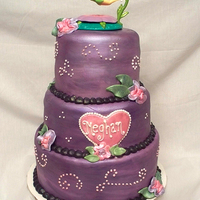 Meghan's Tink Cake  This cake makes me laugh a little...the only thing that is the same as my original design is the topper! Top two tiers are chocolate cake w...