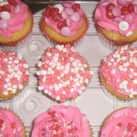 Valentine's Yellow butter cake cuppies with pink bc frosting.