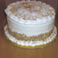 Italian Cream Cake Italian Cream cake with cream cheese icing and cocunut spinkles on top.