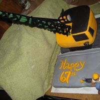 Construction Crane Cake This is the cake I just did for my Fathers 67th Birthday. He is a retired Iron Worker. Both the bridge and the crane are fondant covered...