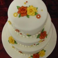 Thanksgiving Wedding Made from scratch: carrot cake, cream cheese icing/filling, vanilla fondant. Gumpaste/fondant flowers, roses & leaves. Royal icing...