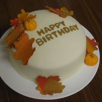 "Fall Birthday 8"" applesauce pound cake with vanilla bc, and white chocolate fondant. Gumpaste/fondant leaves & pumpkins. TFL!"